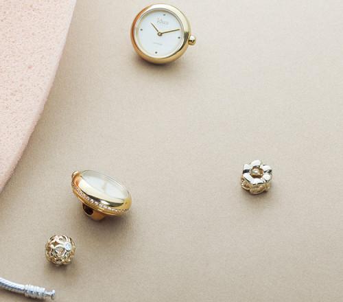 Rocking Charm-Watch mit vergoldetem Gehäuse, Champagner-Zifferblatt und weißen Steinen - RCW3300CZ